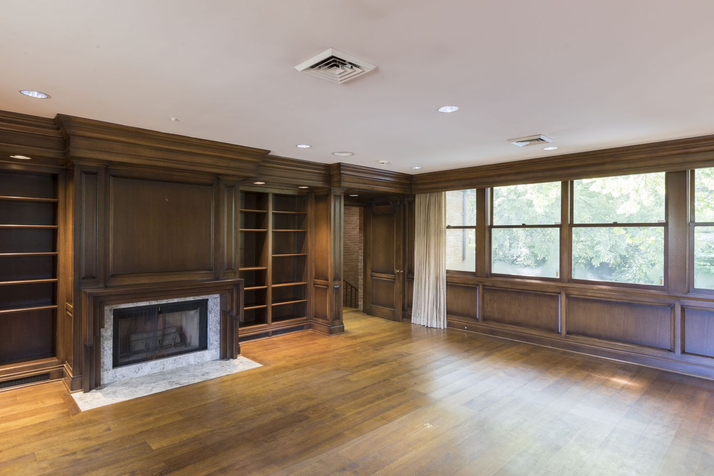 Fireplace and built-in shelves in the den.