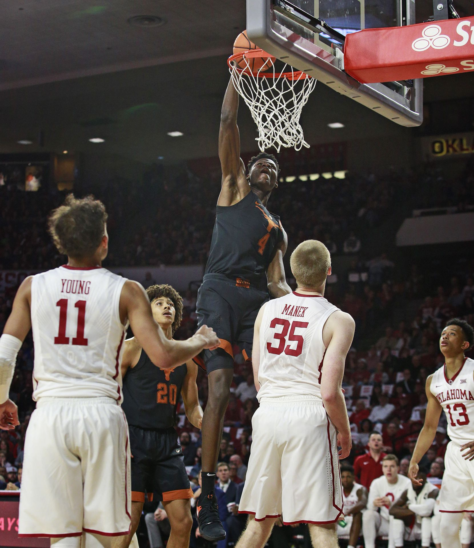 NORMAN, OK - FEBRUARY 17: Mohamed Bamba #4 of the Texas Longhorns dunks the ball against the Oklahoma Sooners at Lloyd Noble Center on February 17, 2018 in Norman, Oklahoma. The Longhorns defeated the Sooners 77-66. (Photo by Brett Deering/Getty Images)