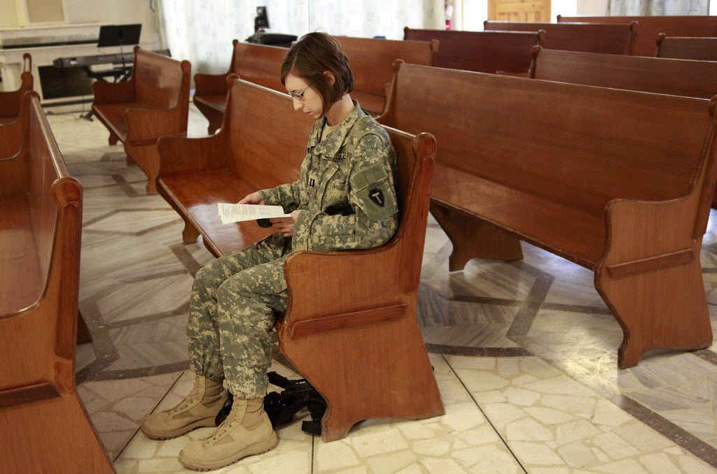 In this Dec. 27, 2009 photo, Capt. Jennifer Zavaglia is one of the first to show up to Sunday Mass in the Palace Chapel at Camp Prosperity in Baghdad.