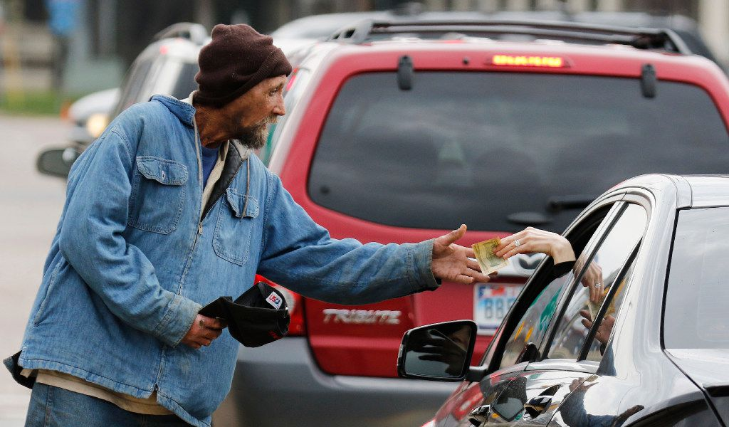 Robert Rushing, 58, works the corner on the service road of Interstate 35 and Oaklawn in March, 2016. He said he is homeless. (David Woo/The Dallas Morning News) ORG XMIT: DMN1603081706472809