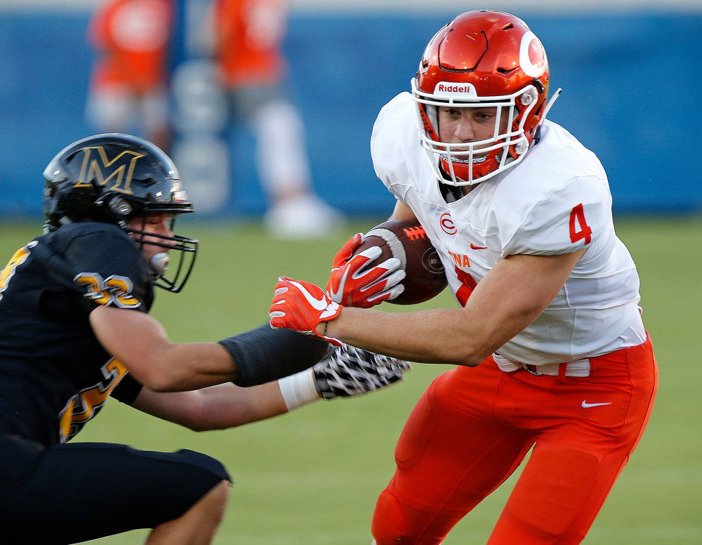 Celina High School running back Logan Point (4) gets by Memorial High School defensive back Christian Pirtle (22) during the first half as Memorial High School hosted Celina High School in a football game played at Toyota Stadium in Frisco on Friday night , August 31, 2018.  (Stewart F. House/Special Contributor)
