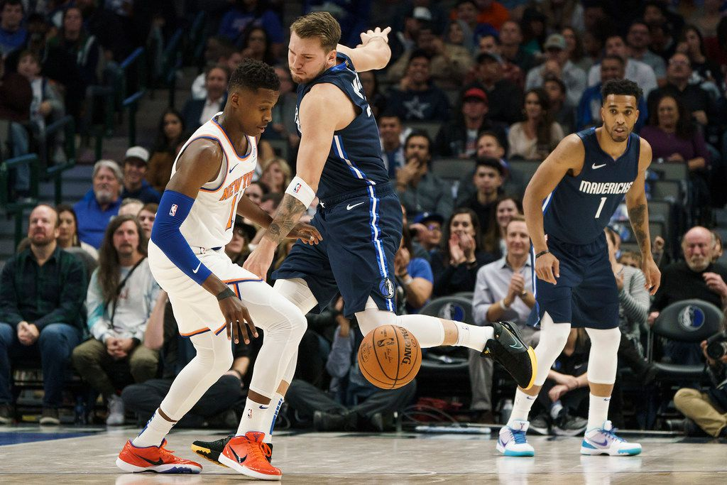 Dallas Mavericks guard Luka Doncic (77) knocks the ball away from New York Knicks guard Frank Ntilikina (11) during the first half of an NBA basketball game at American Airlines Center on Friday, Nov. 8, 2019, in Dallas. (Smiley N. Pool/The Dallas Morning News)