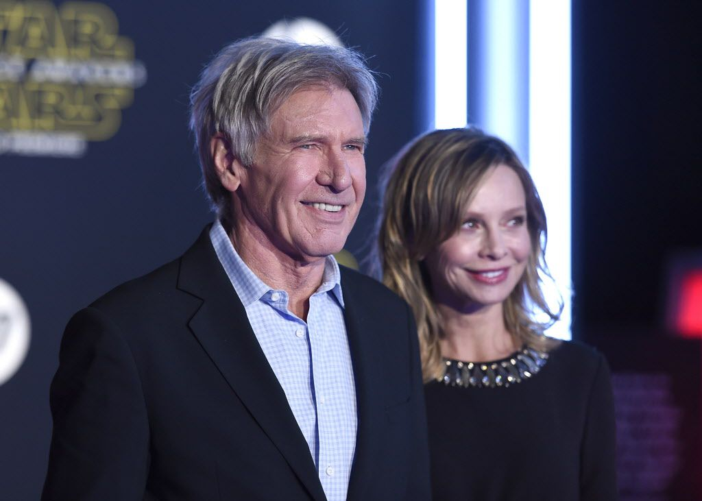 """Harrison Ford, left, and Calista Flockhart arrive at the world premiere of """"Star Wars: The Force Awakens"""" at the TCL Chinese Theatre on Monday, Dec. 14, 2015, in Los Angeles. Ford plays the role of Han Solo in the film."""