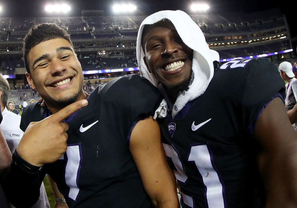 FORT WORTH, TX - OCTOBER 21:  (L-R) Kenny Hill #7 of the TCU Horned Frogs celebrates with Kyle Hicks #21 of the TCU Horned Frogs after the TCU Horned Frogs beat the Kansas Jayhawks 43-0 at Amon G. Carter Stadium on October 21, 2017 in Fort Worth, Texas.  (Photo by Tom Pennington/Getty Images)