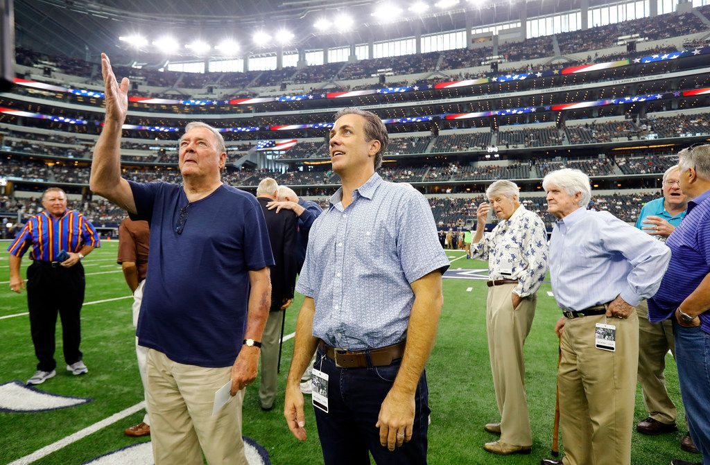 Michael Meredith, left, son of Cowboys great Don Meredith, and former Cowboys quarterback Craig Morton look at the Ring Of Honor following the 1960's player introductions before the game with the Los Angeles Rams, Sunday, October 1, 2017.