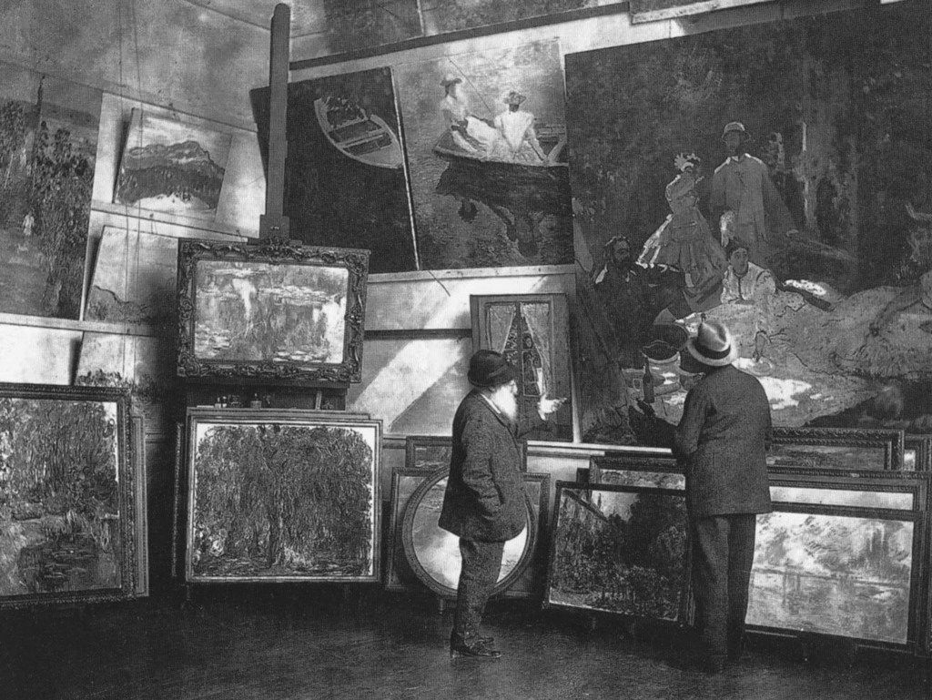 Claude Monet (left) in his second studio in Giverny with the Duc de Trévise, c. 1920. Musée du Louvre, Paris. The Kimbell's Weeping Willow is shown in its original frame, second from left, the bottom row.