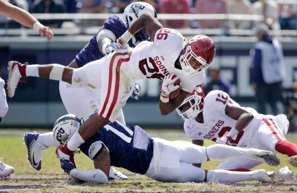 Oklahoma Sooners running back Kennedy Brooks (26) fights for yardage in the third quarter during the Oklahoma Sooners vs. the TCU Horned Frogs NCAA football game at Amon G. Carter Stadium in Fort Worth, Texas on Saturday, October 20, 2018. (Louis DeLuca/The Dallas Morning News)
