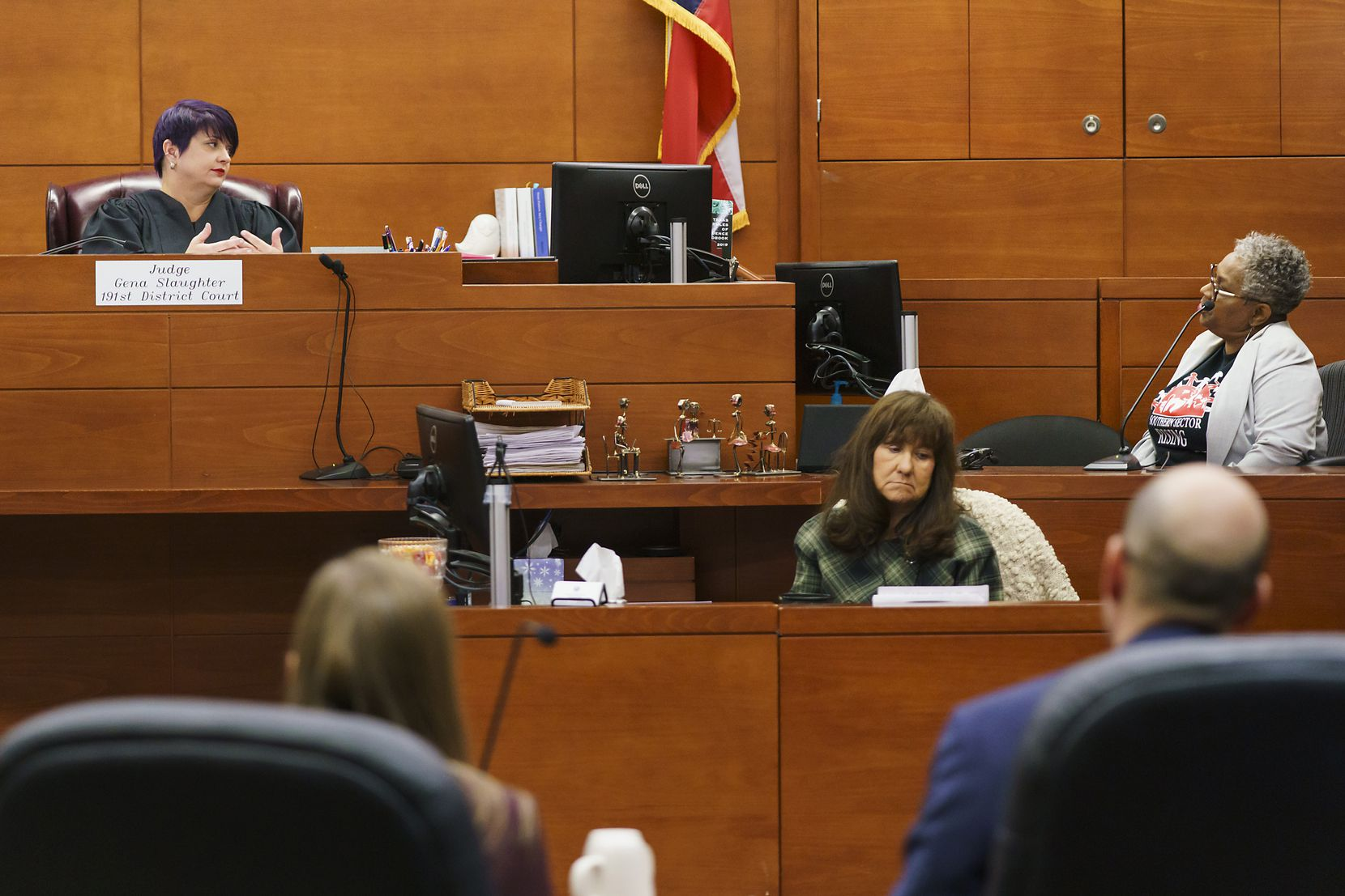 Marsha Jackson, right, is questioned by state District Judge Gena Slaughter, left, during a contempt hearing at the George L. Allen Sr. Courts Building on Friday.