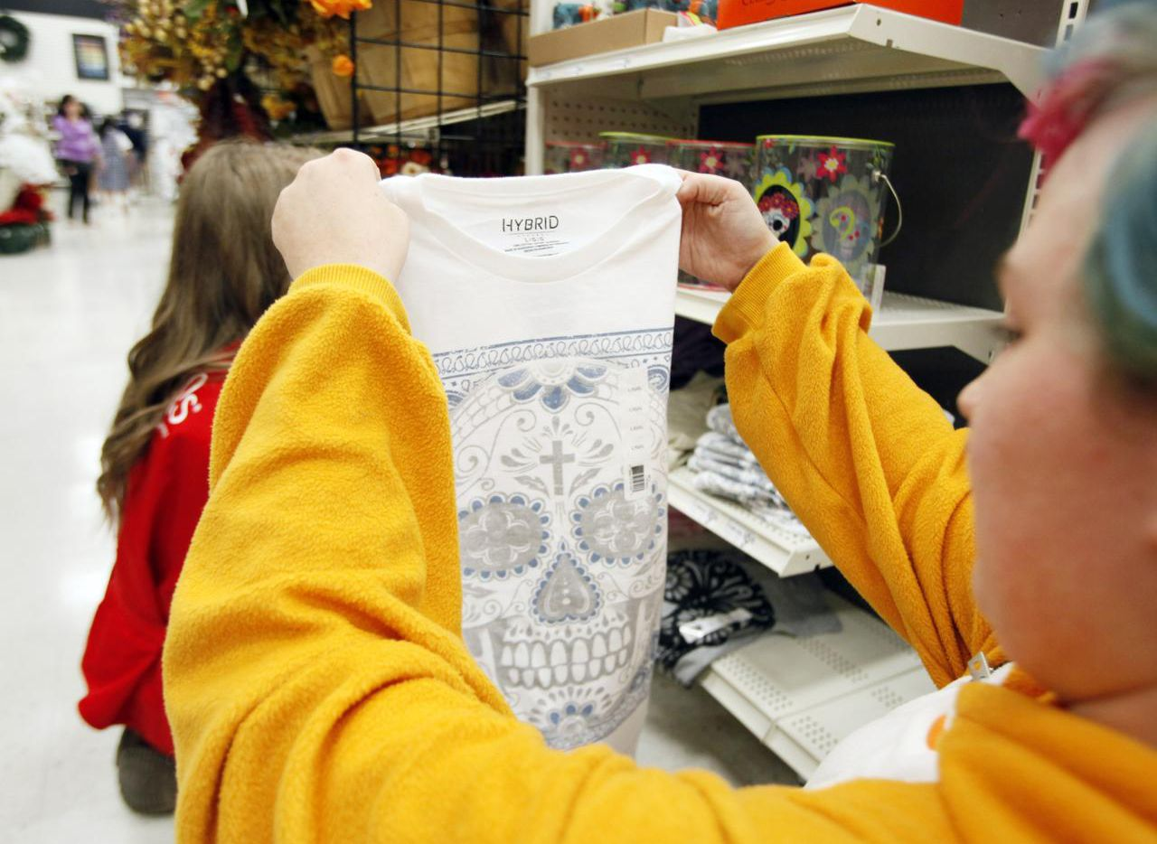 """Destiny Rucker  stocks Day of the Dead merchandise at Michaels in Mesquite. """"Michaels customers across the country are getting into   Day of the Dead decor,"""" says an executive."""