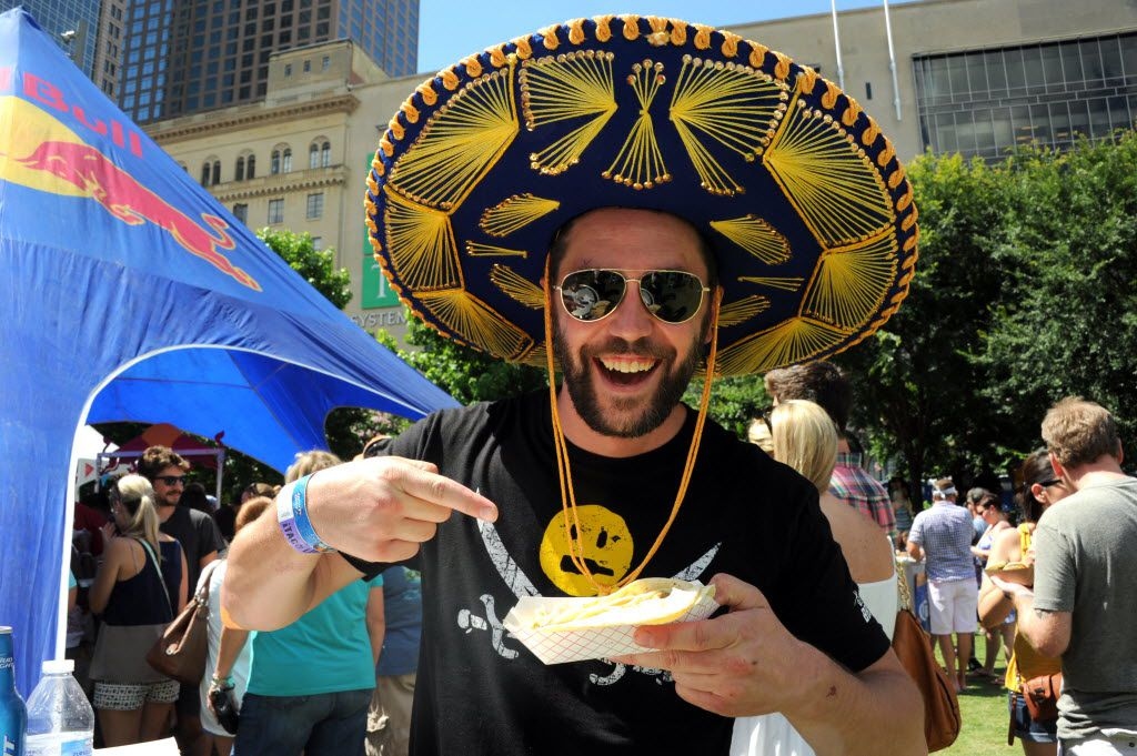 Wes Chambers enjoys tacos at Taco Libre at Main Street Garden in Dallas, TX on June 27, 2015.