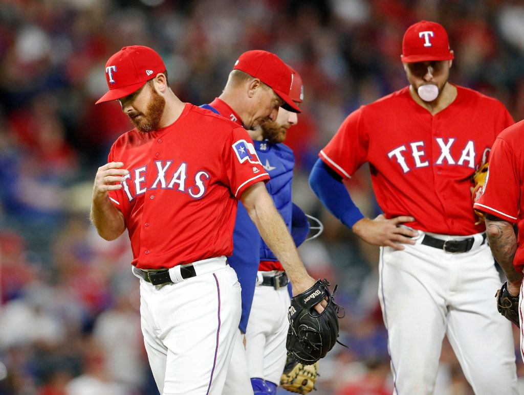 Texas Rangers relief pitcher Sam Dyson (47) exits the mound after Texas Rangers manager Jeff Banister (28) pulled him in the ninth inning in a game against the Cleveland Indians on opening day at Globe Life Park in Arlington on Monday, April 3, 2017. Texas Rangers lost to the Cleveland Indians 8-5. (Vernon Bryant/The Dallas Morning News)
