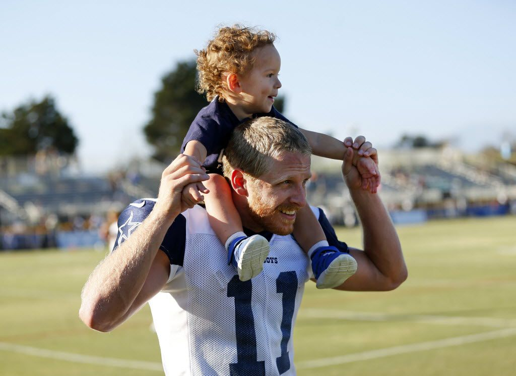 Dallas Cowboys wide receiver Cole Beasley (11) gives his son Ace a ride on his shoulders following afternoon practice at training camp in Oxnard, California, Friday, August 5, 2016. (Tom Fox/The Dallas Morning News)