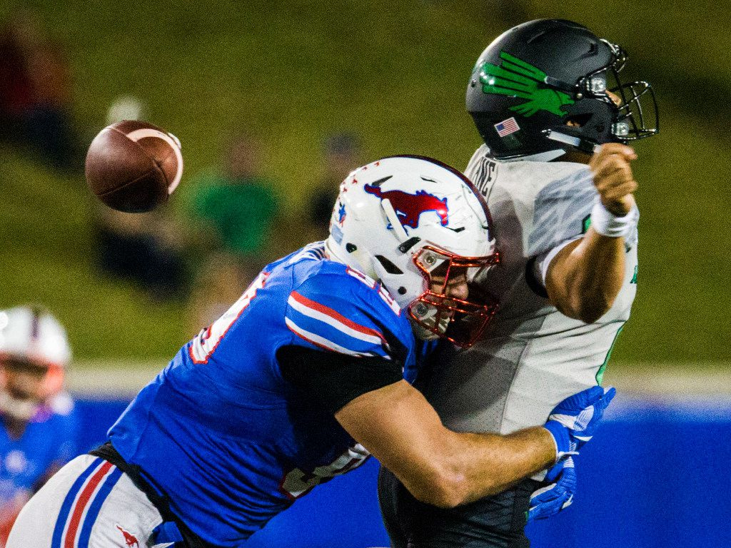 Southern Methodist Mustangs defensive end Justin Lawler (99) sacks North Texas Mean Green quarterback Mason Fine (6) during the third quarter of a football game between UNT and SMU on Saturday, September 9, 2017 at SMU's Ford Stadium in Dallas. (Ashley Landis/The Dallas Morning News)