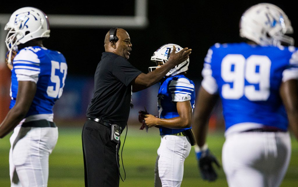 Duncanville head coach Reginald Samples congratulates players after a touchdown during the first quarter of a high school football game between Skyline and Duncanville on Friday, October 4, 2019 at Panther Stadium in Duncanville. (Ashley Landis/The Dallas Morning News)