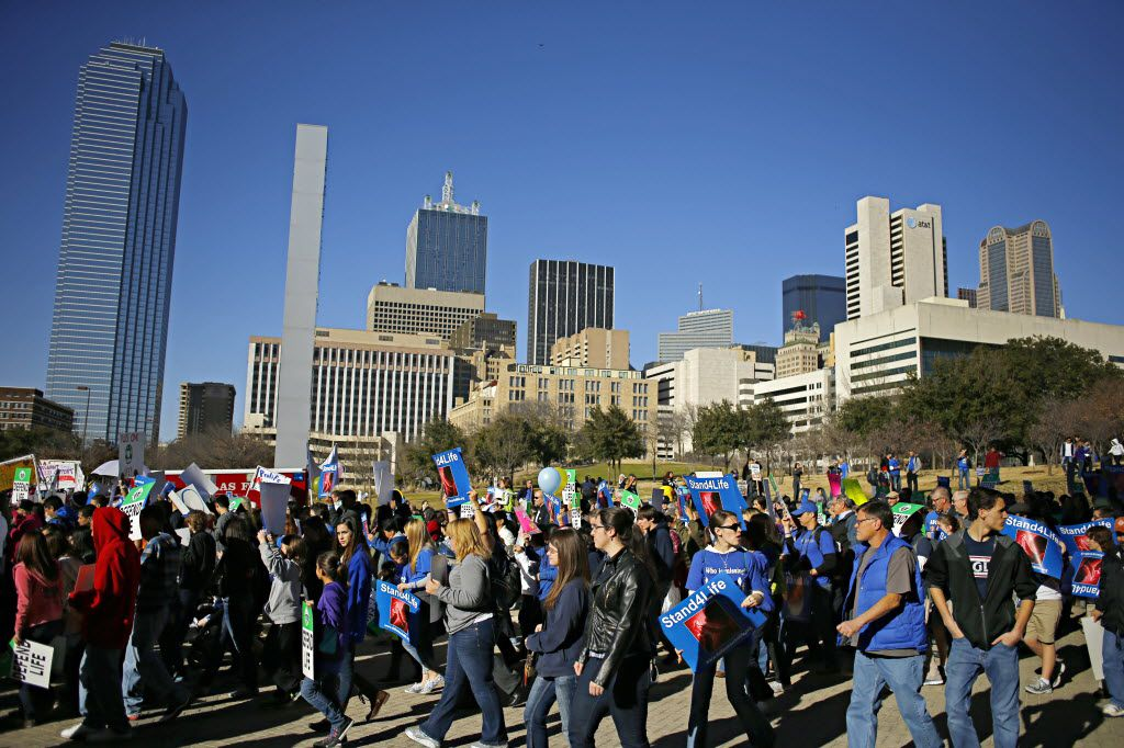 Protesters marched past the Dallas Convention Center during the Dallas March for Life & Rally in January 2014 .