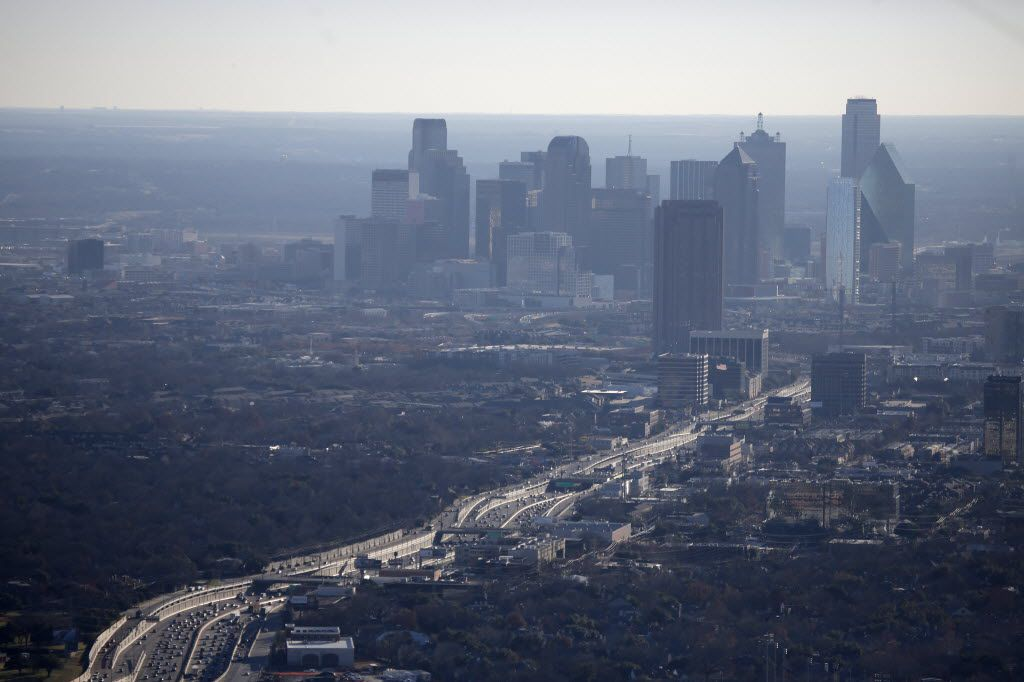 The air hangs with haze as traffic moves on Central Expressway from near the Mockingbird Lane in Dallas.