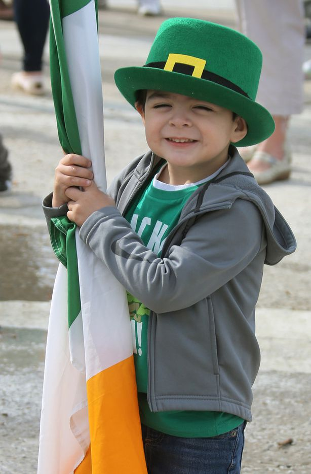Three-year-old Evan Galvan eagerly awaits the start of the parade along the route during the Dallas St. Patrick's Parade & Festival along Greenville Avenue in Dallas on Saturday.