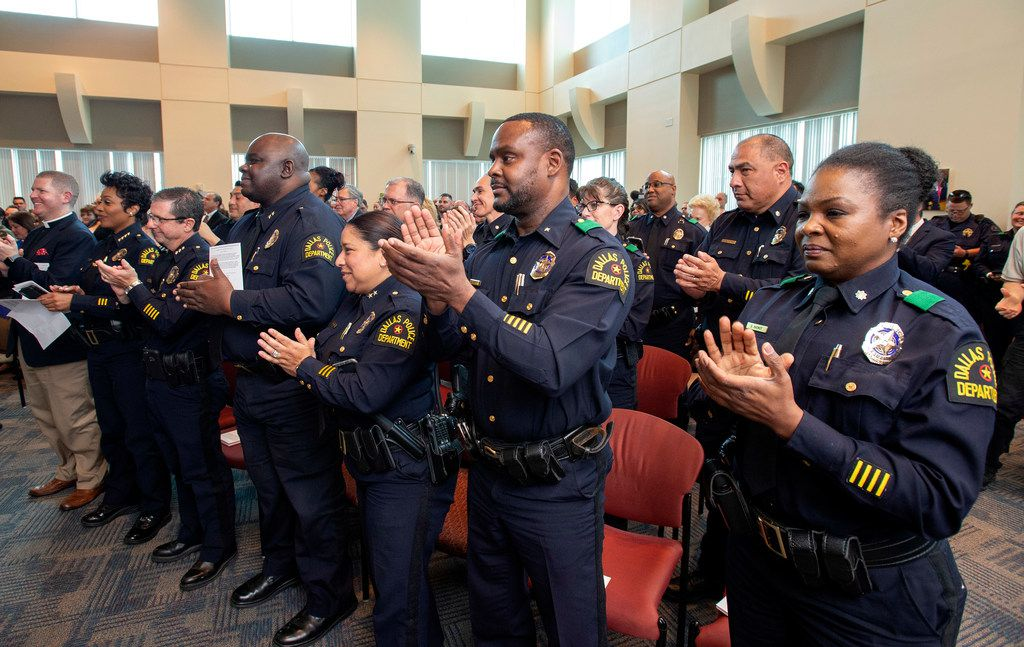 Dallas police officers give a standing ovation as officer Crystal Almeida received the Theodore Roosevelt Police Award on April 11, 2019, at the Jack Evans Police Headquarters in Dallas. Almeida was shot in the face while making an arrest last year at a Home Depot, an incident in which her partner, Rogelio Santander, was shot and killed.