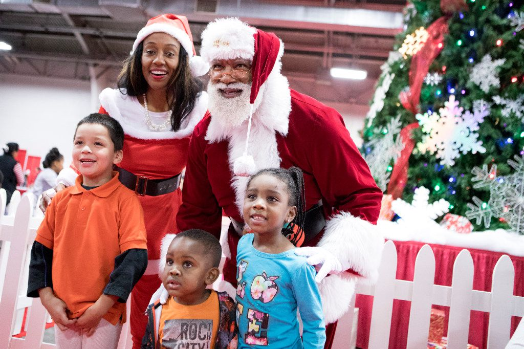 Santa and Mrs. Claus take photos with kids during the S.M. Wright Foundation's 18th Annual Christmas in the Park on Dec. 17, 2016, at Fair Park in Dallas.