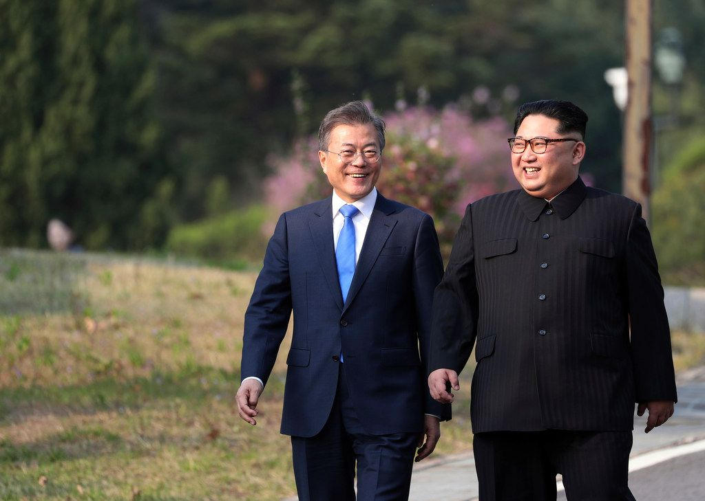 North Korean leader Kim Jong Un (right) and South Korean President Moon Jae-in walk together at the border village of Panmunjom in the Demilitarized Zone in South Korea on Friday.