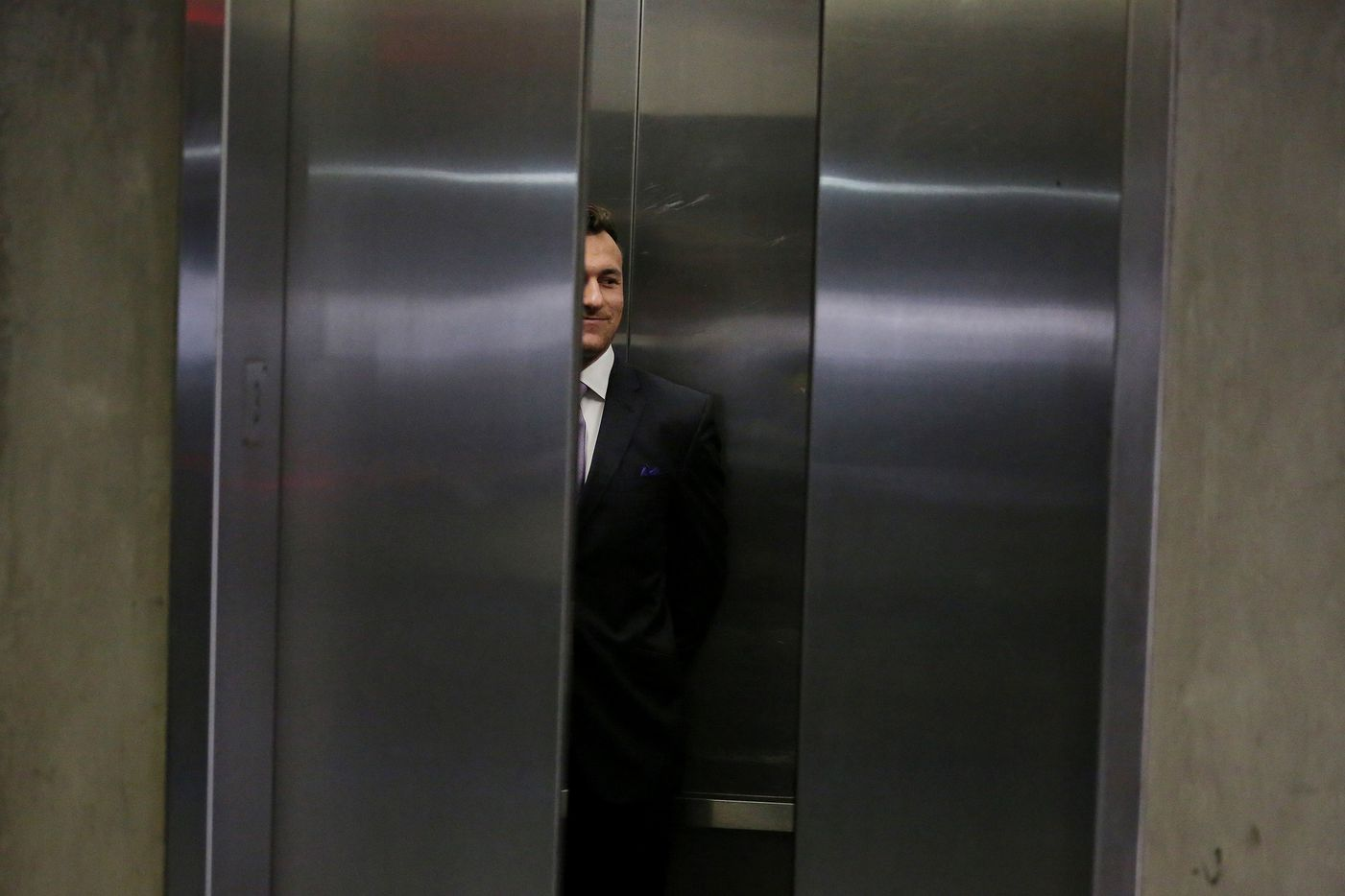 Former Texas A&M quarterback Johnny Manziel enters an elevator in a parking structure following a hearing with Judge Roberto Canas in Dallas County Criminal Court 10 at the Frank Crowley Courts Building in Dallas on Feb. 28. Manziel was in court to report on his progress as called for in the settlement of his misdemeanor domestic violence case.