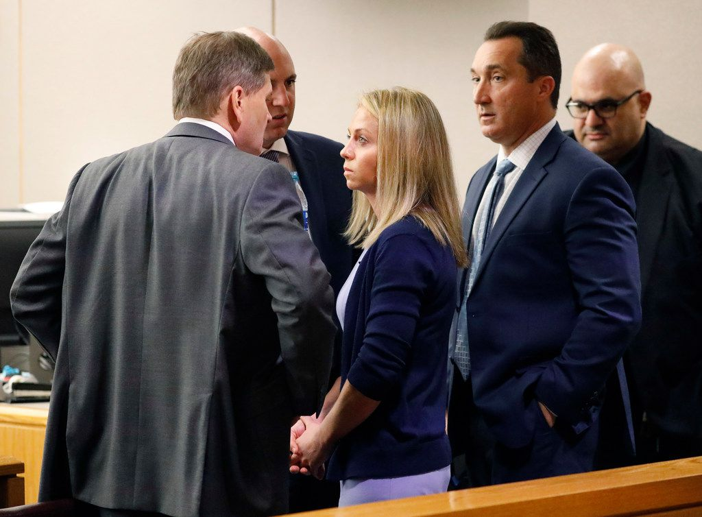 Amber Guyger visits with defense attorneys after taking the stand in her murder trial Friday.