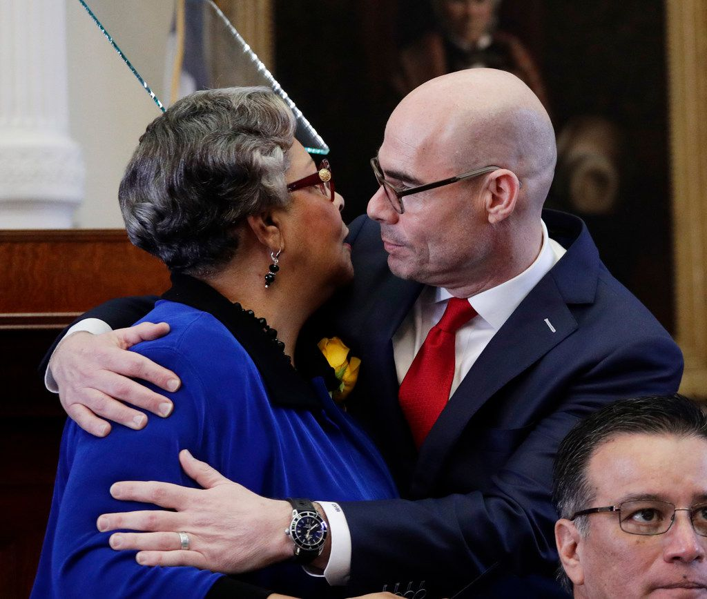 Texas Rep. Senfronia Thompson, D-Houston, left, hugs Rep. Dennis Bonnen, R-Angleton, after making a speaker of the house nomination speech for him during the opening of the 86th Texas Legislative session, Tuesday, Jan. 8, 2019, in Austin, Texas. (AP Photo/Eric Gay)