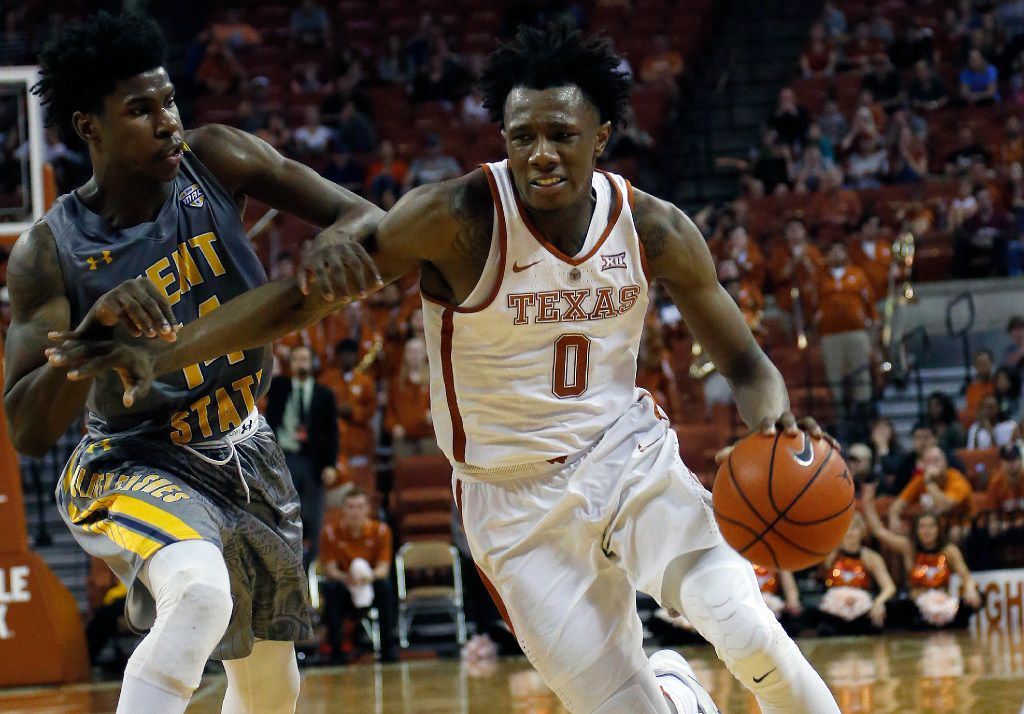 AUSTIN, TX - DECEMBER 27: Tevin Mack #0 of the Texas Longhorns drives around Alonzo Walker #14 of the Kent State Golden Flashes at the Frank Erwin Center on December 27, 2016 in Austin, Texas. (Photo by Chris Covatta/Getty Images)