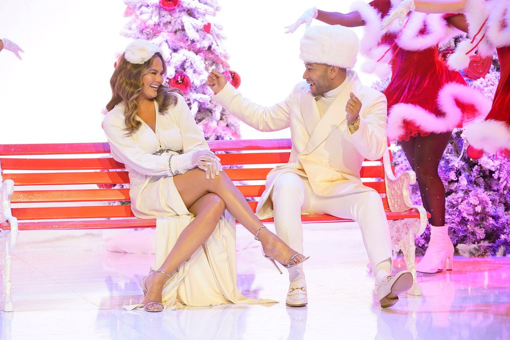 """Chrissy Teigen, left, and her husband John Legend ham it up during """"A Legendary Christmas With John and Chrissy,"""" which aired in November. Legend released his first holiday album, which has the same name."""