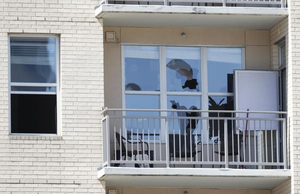 Bullet holes shattered windows at the Vista Apartments.