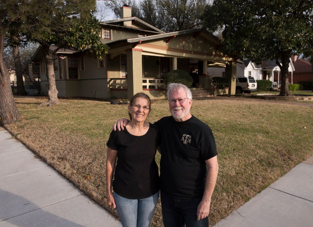Becky Baxter and her husband, Greg, have lived in their 1918 Craftsman home for 16 years. Becky's scaffold is on the back side of the home now, as she continues to remove paint and repaint the house slat by slat.