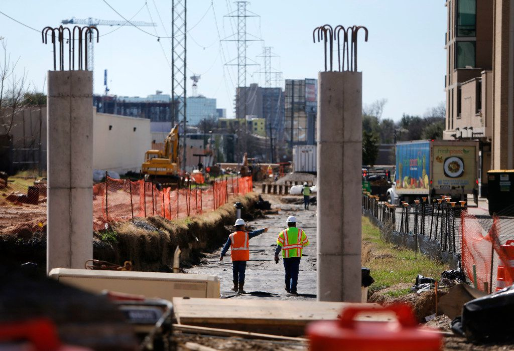 Workers construct on the site of the Katy Trail Bridge on Mockingbird Lane in Dallas on Tuesday, Feb. 21, 2017. (Rose Baca/The Dallas Morning News)