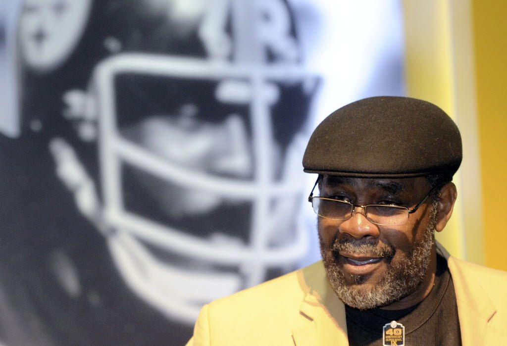 Former Pittsburgh Steelers Hall Of Fame defensive tackle Joe Greene talks to people gathered at a ceremony retiring his jersey number before the NFL football game between the Steelers and the Baltimore Ravens, Sunday, Nov. 2, 2014, in Pittsburgh. (AP Photo/Don Wright) 02062015xBRIEFING