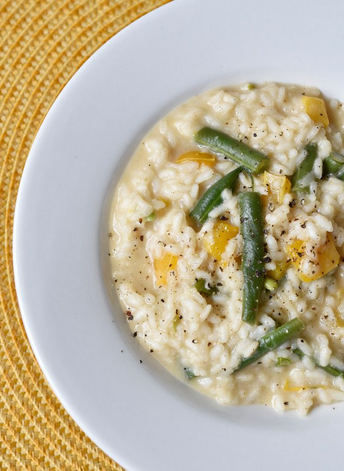 A dish of Marcella Hazan's risotto with green beans and sweet yellow bell peppers