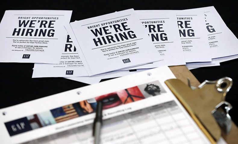 Hourly wages were up 13 percent in April over March, as companies competed for workers and the region's unemployment rate remained low. Look out over the past year, though, and the wage growth is largely confined to certain hot sectors. (2015 File Photo/The Associated Press)