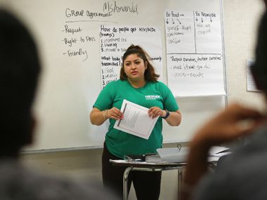 Amanda Mendoza talks with students during a 2017 sex education class in Vickery Meadows in Dallas, run by the North Texas Alliance to Reduce Unintended Pregnancy in Teens. The State Board of Education is revising health course standards, and sex ed is expected to spark big battles.