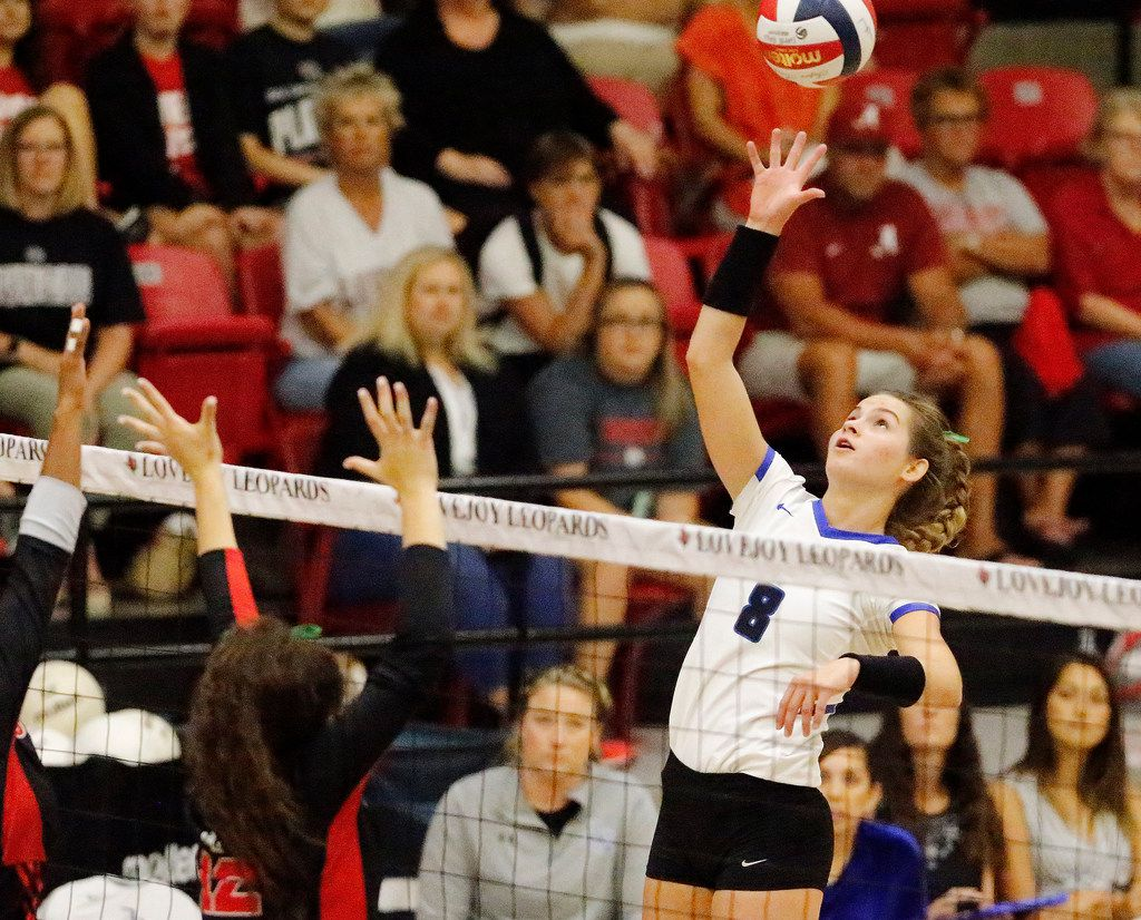 Trophy Club Byron Nelson outside hitter Paige Flickinger (8) tips the ball over the net during Tuesday's 26-24, 28-26, 25-17 win over Lovejoy. (Stewart F. House/Special Contributor)
