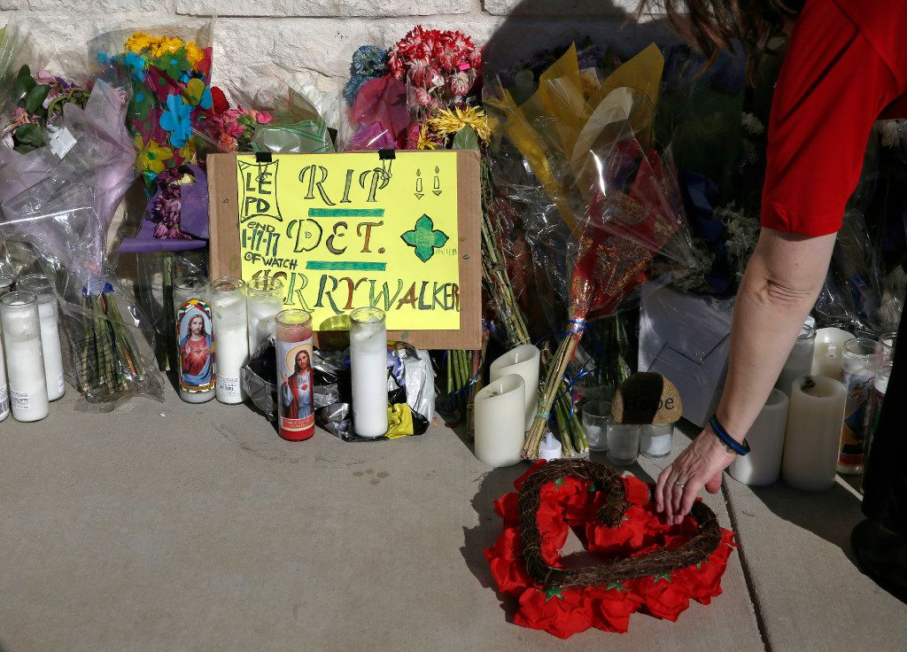People leave flowers and messages at the police station before the procession for Det. Jerry Walker who was killed in the line of duty in Little Elm, Texas on January 23, 2017. (Nathan Hunsinger/The Dallas Morning News)