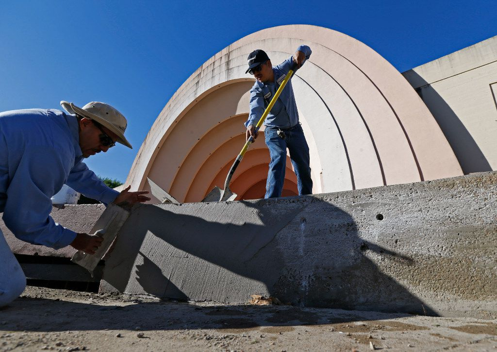 City of Dallas employees worked Thursday on the retaining wall around the orchestra pit in front of the band shell at Fair Park. (Nathan Hunsinger/Staff Photographer)