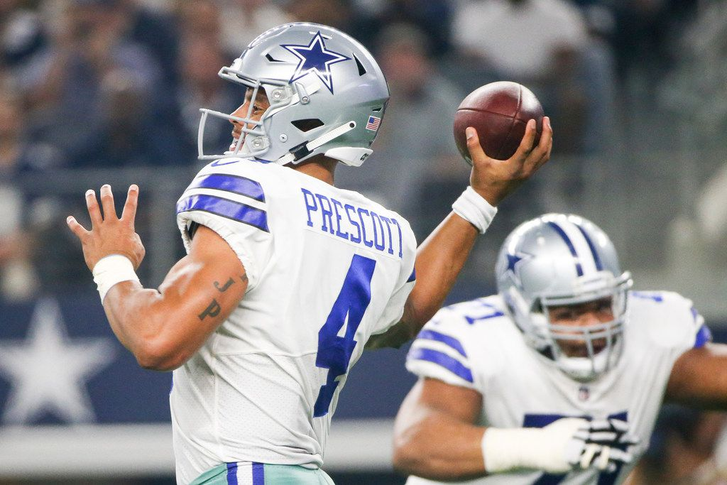 Dallas Cowboys quarterback Dak Prescott (4) makes a pass in the fourth quarter quarter of an NFL game between the Dallas Cowboys and New York Giants on Sunday, September 16, 2018 at AT&T Stadium in Arlington, Texas. (Shaban Athuman/ The Dallas Morning News)
