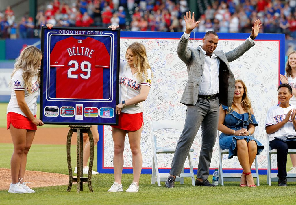 Former Texas Rangers player Adrian Beltre acknowledges cheers from fans as his wife, Sandra, second from right, and son Adrian Jr., look on during a jersey retirement ceremony before the second baseball game of a doubleheader against the Oakland Athletics in Arlington, Texas, Saturday, June 8, 2019. (AP Photo/Tony Gutierrez)