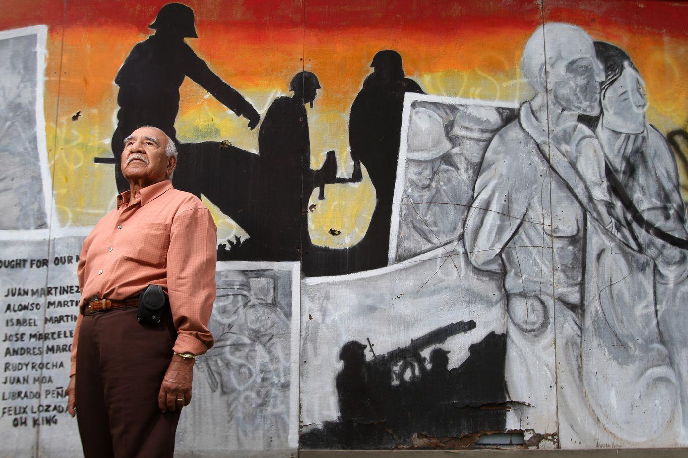 Felix Lozada, 89, a war veteran of World War II, near a mural that bears his name along with other war veterans, on Nov. 7, 2011 in West Dallas.