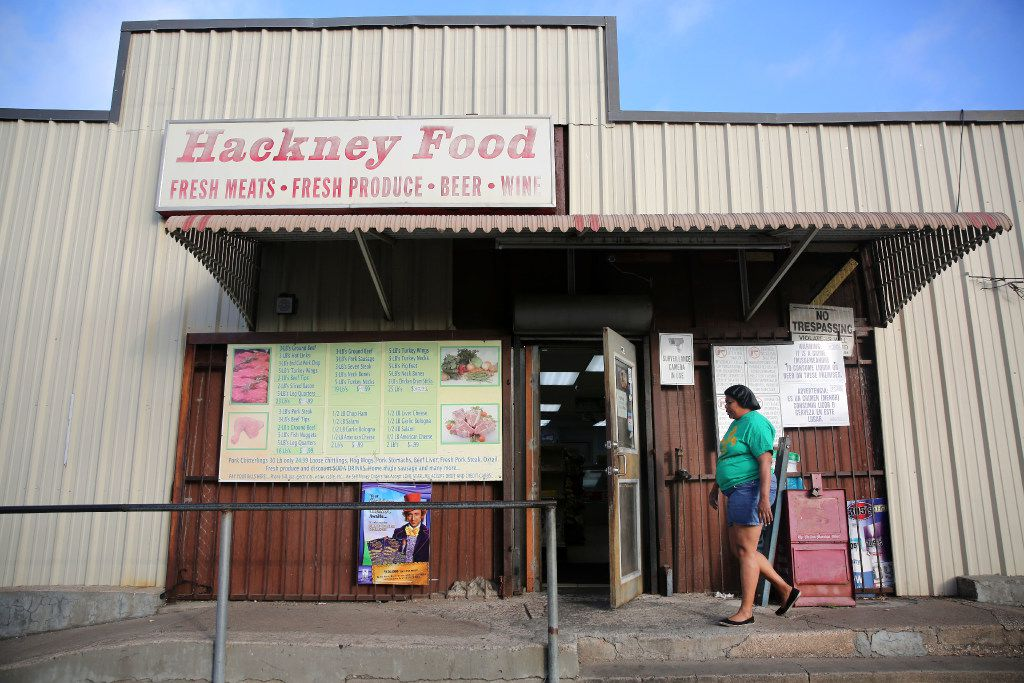 Sharon Duckett walks into Hackney Food to buy meat in the Mill City neighborhood in South Dallas on Tuesday, March 21, 2017. (Rose Baca/The Dallas Morning News)