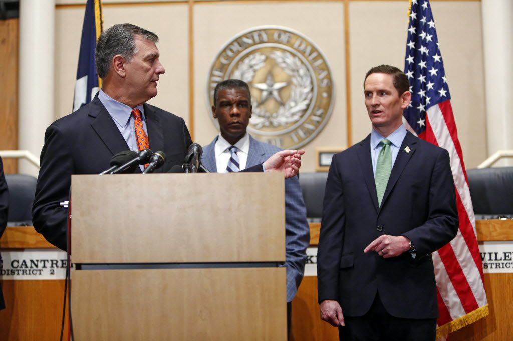 County Judge Clay Jenkins (right) and Mayor Mike Rawlings talk during a news conference about Ebola at the County Commissioners Court on Oct. 20, 2014.