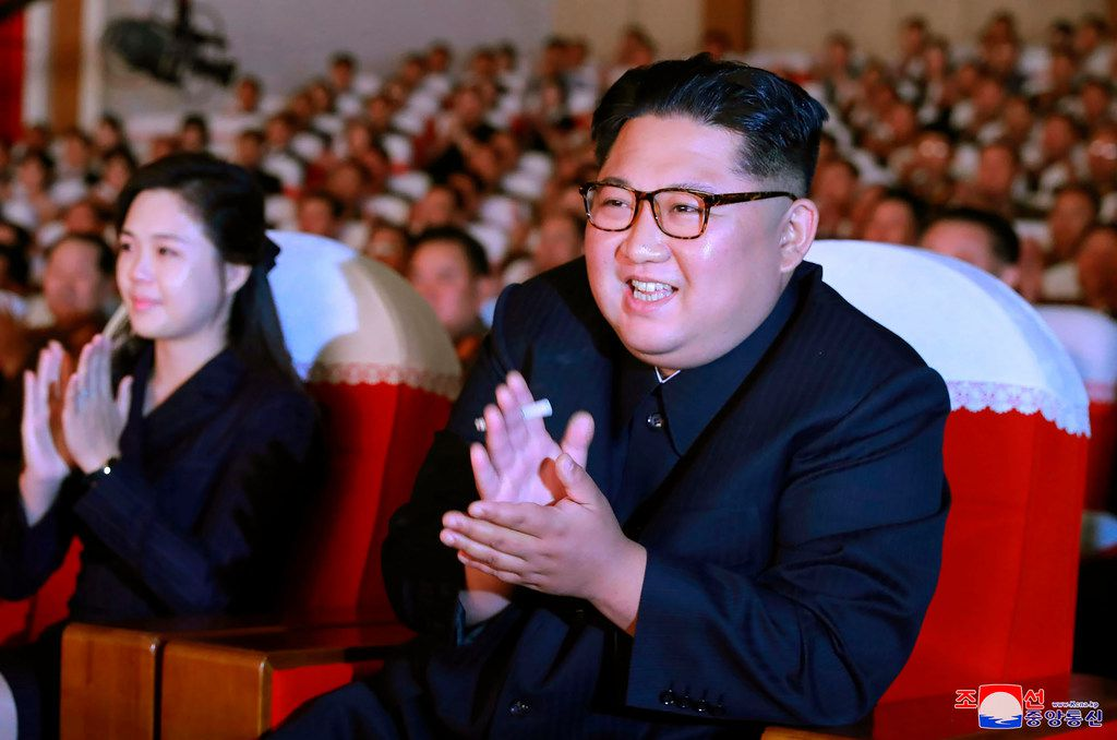 North Korean leader Kim Jong Un and his wife, Ri Sol Ju, applaud a musical performance by the wives of Korean People's Army officers in North Korea.