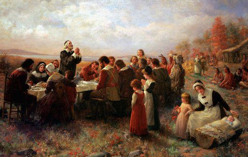 """A detail of the 1914 Jennie Brownscombe painting """"The First Thanksgiving at Plymouth"""" appears at the Pilgrim Hall Museum in Plymouth, Mass."""