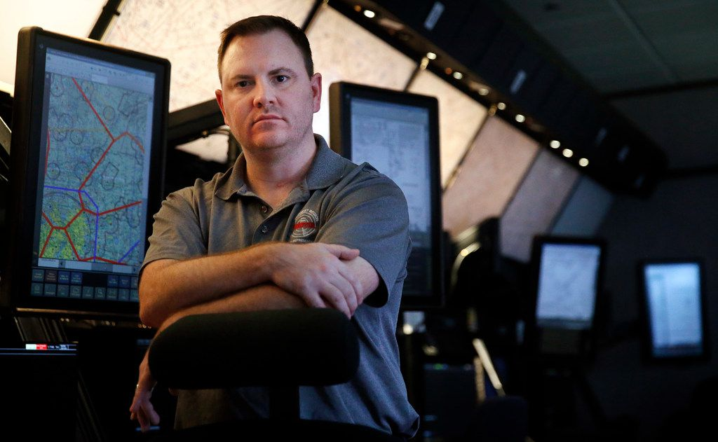 Nick Daniels, a local leader for the National Air Traffic Controllers Association, has no choice but to come to work, ensuring that aircraft make their destinations safely during the government shutdown. Daniels is pictured in the simulation room of their Fort Worth offices.