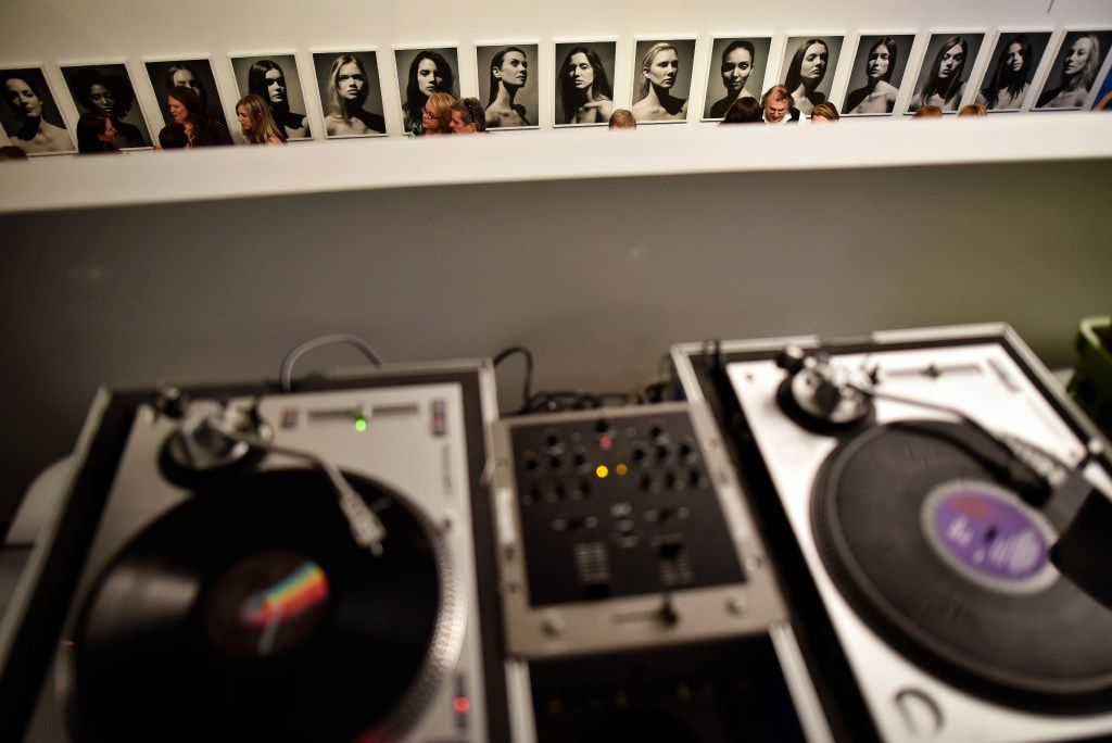 A DJ's turntables during opening night of Fredrik Broden's exhibit at Tractorbeam's gallery in downtown Dallas.