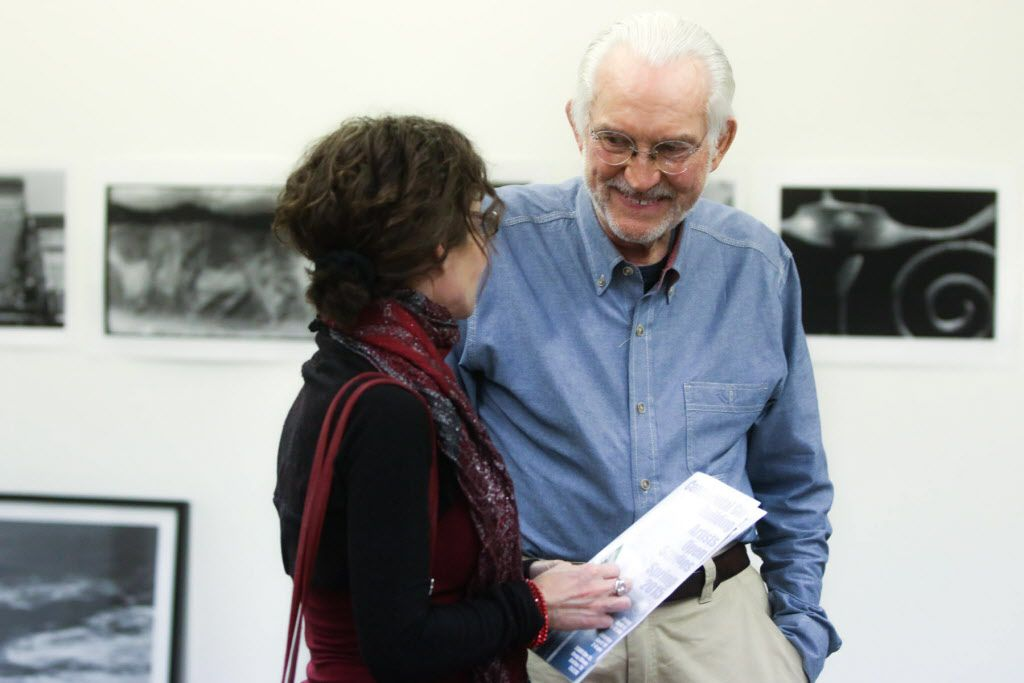 Leonard Volk chats with a customer at the Continental Gin Building Open Studios on April 18, 2015