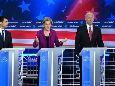 Presidential hopefuls Pete Buttigieg, Sen. Elizabeth Warren and Joe Biden participate in the fifth Democratic primary debate of the 2020 campaign, co-hosted by MSNBC and The Washington Post at Tyler Perry Studios in Atlanta on Nov. 20, 2019.